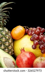 Cropped vertical view of many colorful fruits on black background with reflection