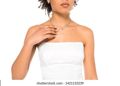 cropped view of african american bride touching necklace isolated on white