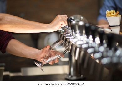 Cropped View of Bartender Using Beer Tower