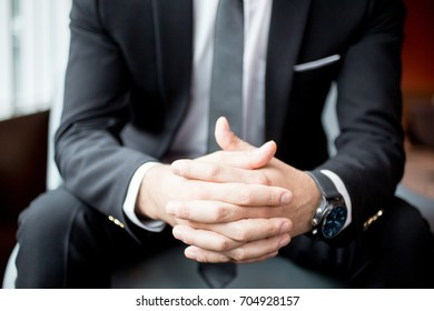 Cropped View of Businessman Clasped Hands