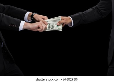 cropped view of businessman giving money and bribing business partner, isolated on black
