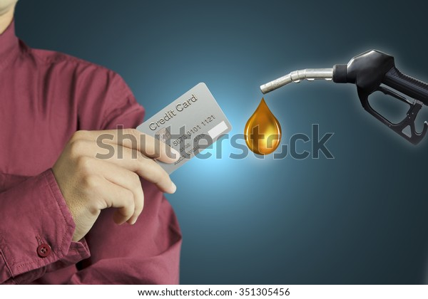 Cropped view of Businessman hand holding credit card in gas station