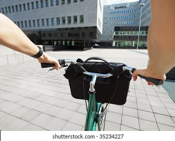 Cropped view of businesswoman going to work by bike