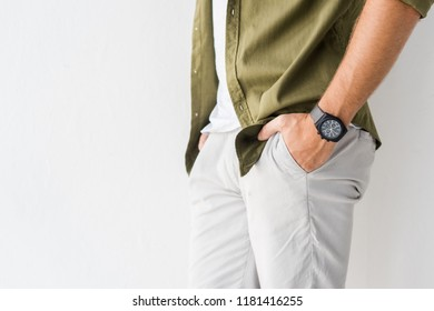 cropped view of casual man with hands in pockets