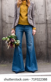 cropped view of elegant stylish girl with bouquet of flowers