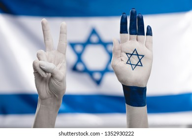 cropped view of female hands with star of david showing peace sign near flag