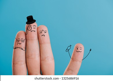 cropped view of fingers as snobs looking at drunk man isolated on blue