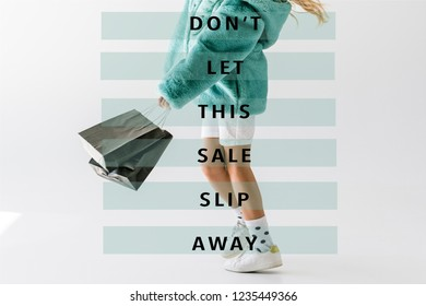 cropped view of girl in turquoise fur coat holding black shopping bags on white, dont let this sale slip away inscription