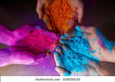 cropped view of hands with holi powder for Hindu spring festival of colours