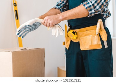 cropped view of handyman wearing glove on hand