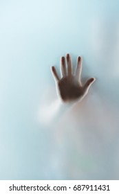 cropped view of human hand touching glass, selective focus