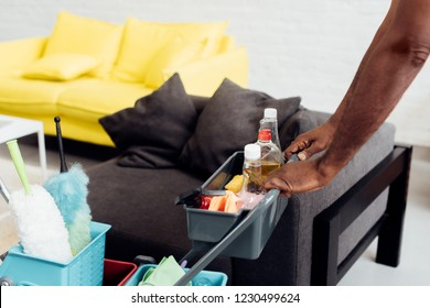cropped view of male african american hands with housecleaning equipment