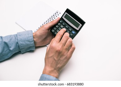 cropped view of male hands with calculator and notepad isolated on white