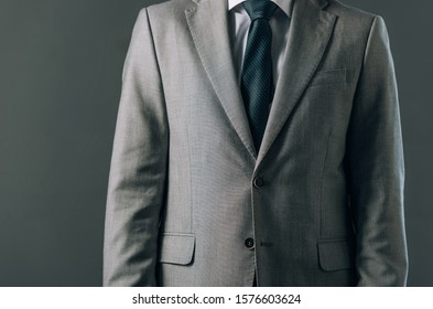 Cropped view of man in suit isolated on grey