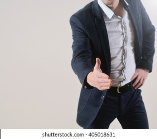 cropped view of a man's hand extended towards you for a handshake; business concept