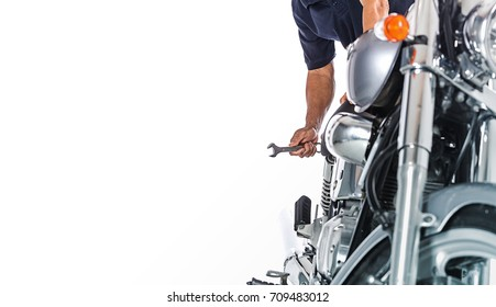 Cropped view of Motorcycle mechanic on white background
