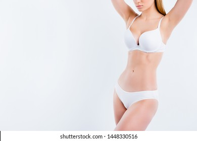 Cropped view of nice attractive adorable fit thin sportive gorgeous girl with healthy perfect figure medical clinic procedure liposuction fat burning isolated over light gray background