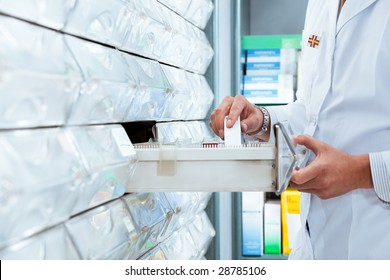 cropped view of pharmacist taking medicine from drawer. Copy space