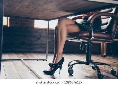 Cropped view photo of charming attractive legs strict serious lady sit desk leather chair solve company problem fabulous magnificent gorgeous elegant checked skirt red sweater interior