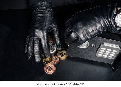 Cropped view of robber stealing bitcoin from safe