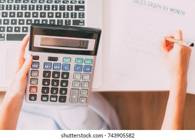 Cropped View of Sales Manager Using Calculator