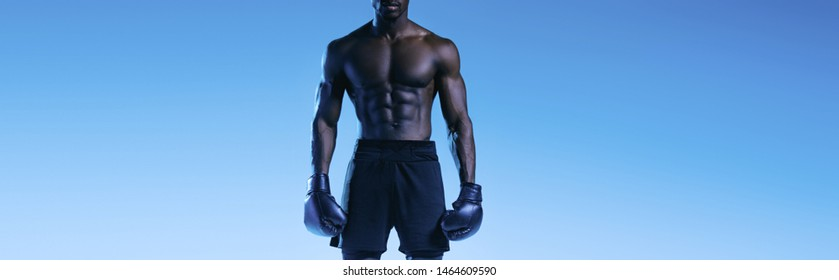cropped view of shirtless african american boxer on blue background, panoramic shot