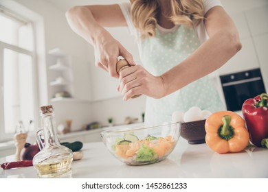 Cropped view of wavy-haired lady making fresh homemade domestic vitamin complex tasty yummy delicious dinner lunch in light white interior kitchen indoors