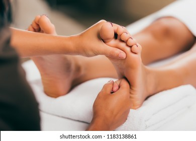 cropped view of woman relaxing in massage salon