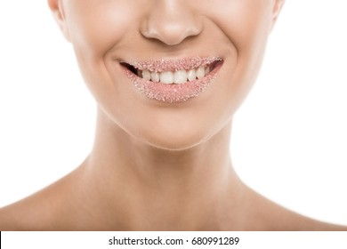 cropped view of woman with sweet sugar lips, isolated on white