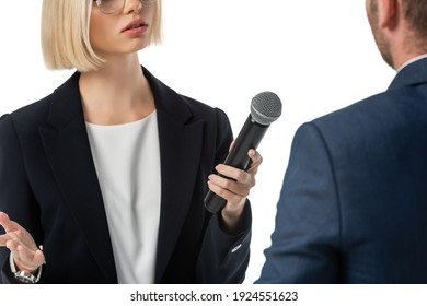 cropped view of young news anchor taking interview from businessman isolated on white, blurred foreground