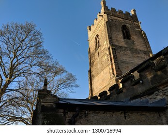 CROPWELL BISHOP, ENGLAND - DECEMBER 20, 2018: exterior of St Giles' Church, Cropwell Bishop, with many beautiful stained glass windows and other architectural features