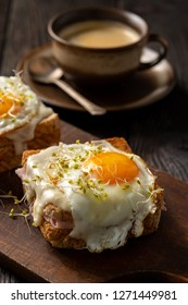 Croque madame, hot french toasts with ham , cheese and egg.