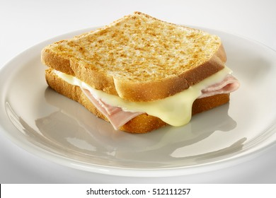 Croque-monsieur sandwich, on a white plate, isolated on white background