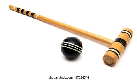 croquet mallet and ball over white