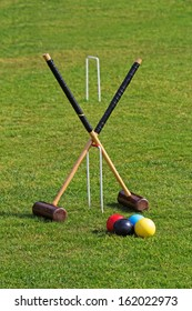 Croquet mallets, balls and hoops ready for a game