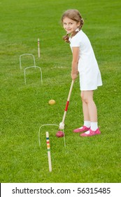 Croquet Player Making Score
