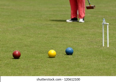 Croquet player playing Croquet in Croquet club. Active senior retirement concept. Copy space