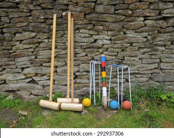 Croquet Set Resting Against a Dry Stone Wall at Dyrham Park, near Bath, Somerset, England, UK