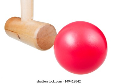 croquet wooden mallet strikes red ball close up isolated on white background