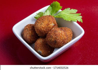 Croquetas con jamon typical spanish meal on a white plate