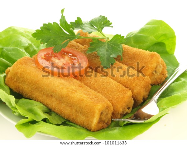 Croquette dish with lettuce and tomato slice