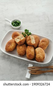 Croquettes are food consisting of ragout coated with egg white and panir flour and then fried. Very tasty and tasty. This croquette is chicken flavored. Served in a white plate and parsley garnish.