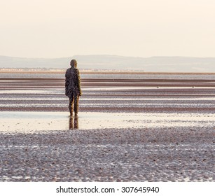 Crosby, Merseyside, UK. August 17th 2015. Another Place, Statues by Antony Gormley on Crosby Beach.