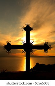 Cross against golden sunset of Holy Mount Athos