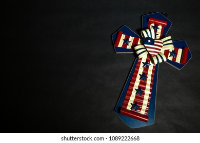 Cross with American Flag on Black Background