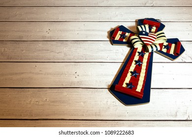 Cross with American Flag on wooden background