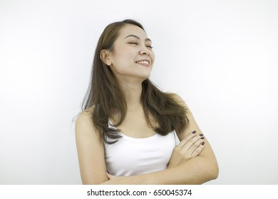 Cross arms, close eyes  with happy smiling face, pose by lifestyle of asian beautiful woman portrait in casual dress looking front, standing and thinking positive in grey background.