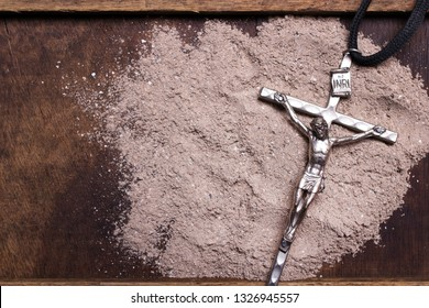 Cross and ash - symbol of Ash Wednesday. Copy space