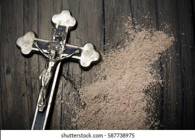 Cross and ash - symbols of Ash Wednesday.