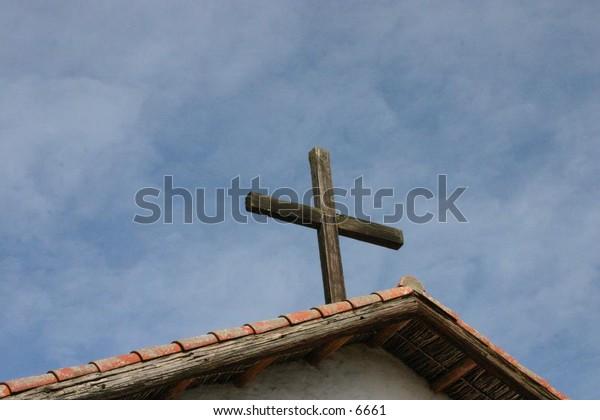 cross atop a steeple